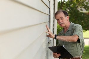 home inspection chicago home inspector inspecting a corner of the house